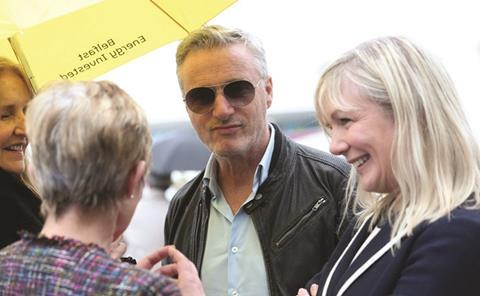 Eddie irvine greets belfast city council ceo suzanne wylie and councillor mairead o'donnell