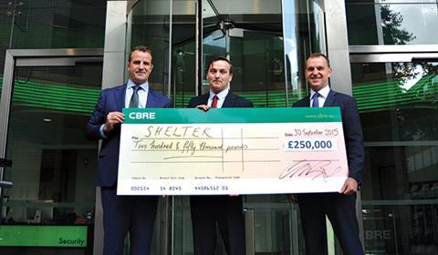 Cheque please: (L-R) Ciaran Bird, UK managing director at CBRE; Campbell Robb, chief executive at Shelter; and Steve Timbs, chairman of CBRE's UK communities and giving committee