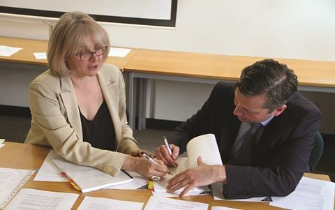Lisa Scenna (MD of MSIL) and Steve Faber (MD of Herts Living) signing agreement