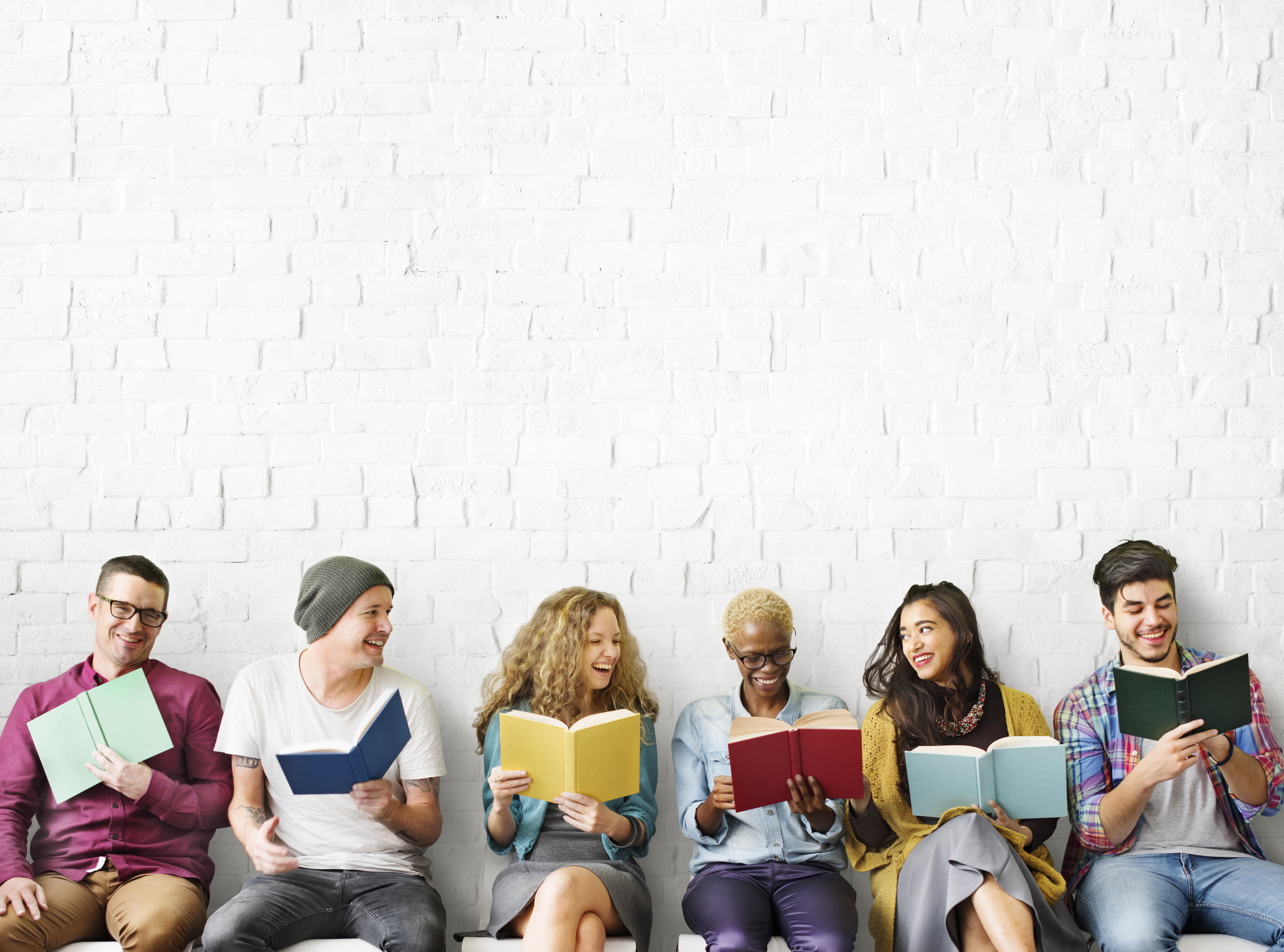 Diverse people reading books